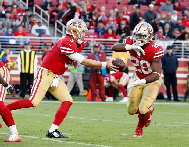 San Francisco 49ers starting quarterback C.J. Beathard (3) passes the ball to San Francisco 49ers' Carlos Hyde (28) against Arizona Cardinals in the second quarter of their NFL game at Levi's Stadium in Santa Clara, Calif. on Sunday, Nov. 5, 2017. (Josie Lepe/Bay Area News Group)