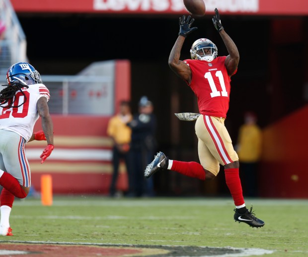 San Francisco 49ers' Marquise Goodwin (11) makes a catch which he would run in for a touchdown against New York Giants' Janoris Jenkins (20) in the second quarter of their NFL game n Santa Clara, Calif. on Sunday, Nov. 12, 2017. (Nhat V. Meyer/Bay Area News Group)