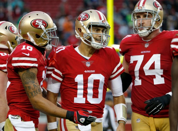 San Francisco 49ers quarterback Jimmy Garoppolo (10) and wide receiver Louis Murphy (18) celebrate their last-minute touchdown against the Seattle Seahawks in an NFL game at Levi's Stadium in Santa Clara, Calif., Sunday, November 26, 2017. (Karl Mondon/Bay Area News Group)