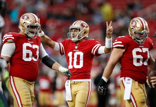 San Francisco 49ers' Jimmy Garoppolo (10) call play against Seattle Seahawks in the fourth quarter of their NFL game at Levi's Stadium in Santa Clara, Calif. on Sunday, Nov. 26, 2017. (Josie Lepe/Bay Area News Group)