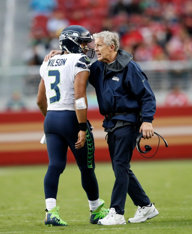 Seattle Seahawks' Russell Wilson (3) talks with Seattle Seahawks head coach Pete Carroll as he leaves the field in the fourth quarter of their NFL game at Levi's Stadium in Santa Clara, Calif. on Sunday, Nov. 26, 2017. (Josie Lepe/Bay Area News Group)