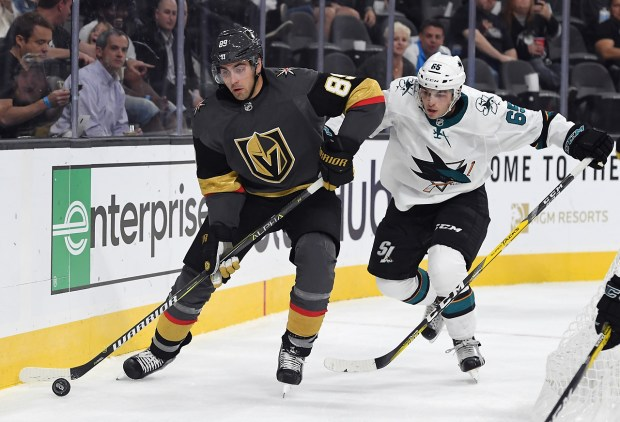 Alex Tuch #89 of the Vegas Golden Knights skates behind the net ahead of Danny O'Regan #65 of the San Jose Sharks during the second period of their preseason game at T-Mobile Arena on October 1, 2017 in Las Vegas, Nevada. (Ethan Miller/Getty Images)