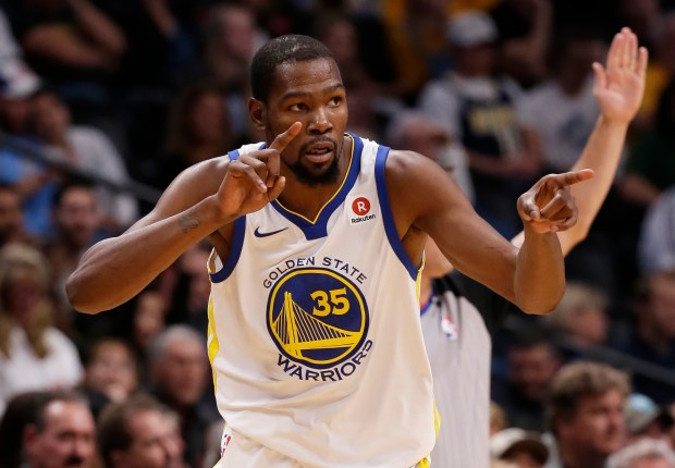 Golden State Warriors forward Kevin Durant celebrates after hitting a three-point basket against the Denver Nuggets during the third quarter of an NBA basketball game Saturday, Nov. 4, 2017, in Denver. (Photo by Jack Dempsey)