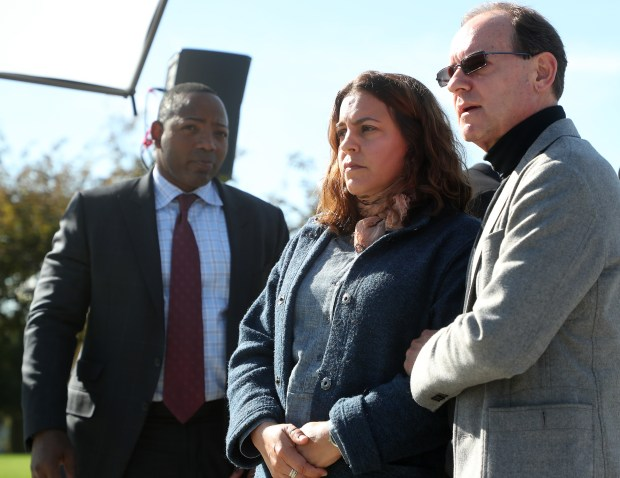 Attorney Waukeen McCoy, left, Susanna Jones, center, and Ron Hayduk, right, wait for the start of press conference near The Wave Waterpark on Tuesday, Nov. 14, 2017, in Dublin, Calif. Susanna Jones and Ron Hayduk gathered with their attorney Waukeen McCoy to announce a lawsuit against the city, the owners of the park, the manufacturer of the slide and the contractor which assembled a water slide at the park that injured their son. (Aric Crabb/Bay Area News Group)