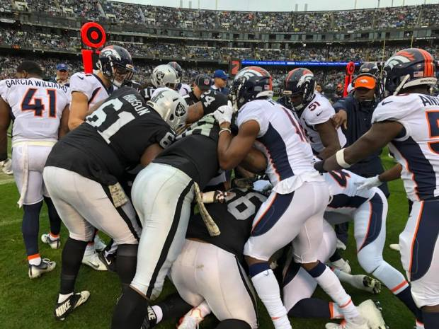 Oakland Raiders players get into a physical altercation with the Denver  Broncos in the first quarter cde7959d5
