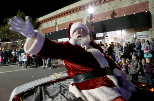Santa Claus waves to spectators as the Children's Light Parade makes its way along Main Street at the Holiday Frolic celebration in Martinez, Calif., on Friday, Dec. 2, 2016. (Anda Chu/Bay Area News Group)
