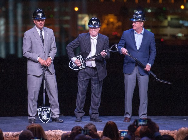 Oakland Raiders owner Mark Davis, center, clowns with his shovel along with Nevada Governor Brian Sandoval, left, and NFL Commissioner Roger Goodell as they prepare to turn the first earth at the groundbreaking ceremony for the Raiders Las Vegas Stadium at the Polaris Avenue site in Las Vegas on Monday, Nov. 13, 2017. (Mark Damon/Las Vegas News Bureau)