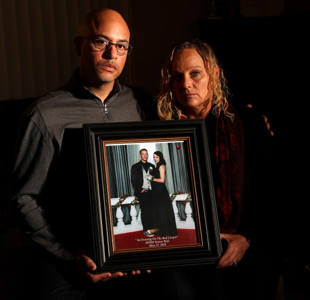 David Gregory, left, and his wife Kim are photographed with a picture of their daughter Michela, and her boyfriend Alex Vega. Michela Gregory and Alex Vega both died in the Ghost Ship fire on December 2, 2016. (Aric Crabb/Bay Area News Group)