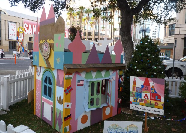 "Adobe volunteers built a playhouse-sized version of Disneyland's ""It's aSmall World"" as part of the Habitat for Humanity Playhouse Build, which features nine companies competing for the ""Cocoa Cup."" (Sal Pizarro/Bay Area News Group)"