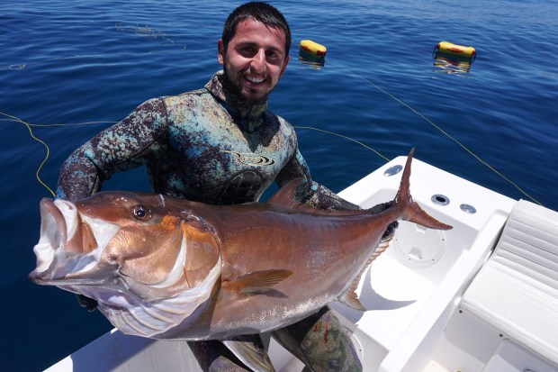 Grigor Azatian displays his catch, an amberjack, on a June 2016 trip to Mexico's Sea of Cortez. Azatian, a UC-Irvine grad and computer science student, was bitten by a shark near Stillwater Cove in Pebble Beach. He's expected to recover. (Courtesy Armen Azatian)