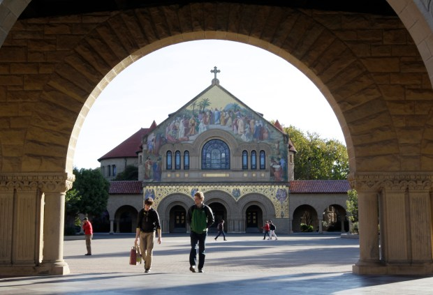 Two Stanford University students walk in front of Stanford Chapel on the Stanford University campus in Palo Alto, Calif., Wednesday, Feb. 15, 2012. (AP Photo/Paul Sakuma)