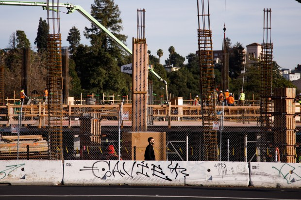 Construction for mixed-use residential and business project is seen on Nov. 28, 2017 in downtown, Oakland. Oakland saw a 86 percent jump in home prices in the past five years according to the Federal Housing Finance Agency. (Dai Sugano/Bay Area News Group)