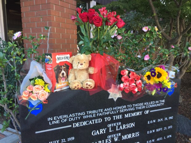 A shrine forms at Sunnyvale Department of Public Safety headquarters in honor of Jax, a police dog killed by a stabbing suspect who himself was fatally shot by police during a domestic violence call Oct. 31, 2017.
