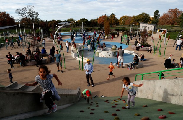 Visitors enjoy the unusually warm weather at the Rotary Playgarden in San Jose, Calif. on Friday, November 23, 2017. (Josie Lepé/Bay Area News Group)