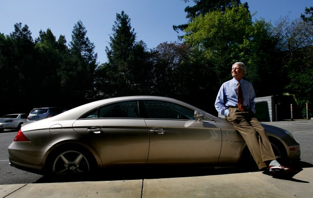 Portrait of Don Lucas next to his car, photographed at his office in Los Gatos on April 6, 2007. Lucas is one of the alums featured in the San Jose State University 150th Anniversary alumni interview section. (Joanne Ho-Young Lee/Mercury News)