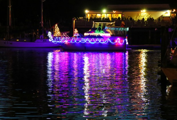 A decorated boat motors through Santa Cruz Harbor at Saturday's lighted boat parade. (Fred Arrellano/Contributed)