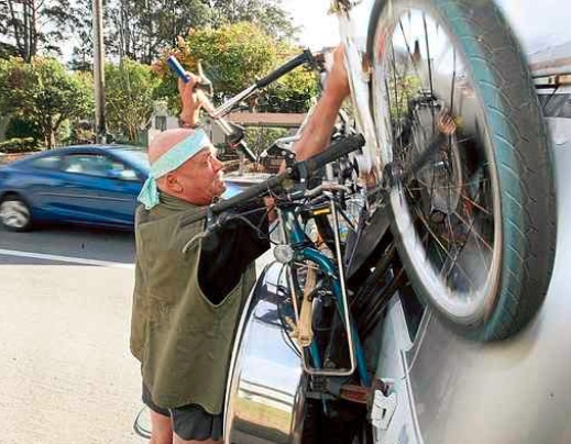 Warren West pulls his bike off the van in which he lives around Santa Cruz. (Dan Coyro -- Santa Cruz Sentinel)