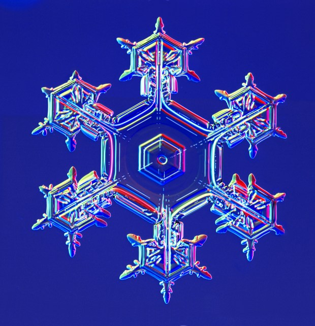 A snowflake, photographed in the field by CalTech physics professor Kenneth G. Libbrecht. (Courtesy of Kenneth G. Libbrecht)