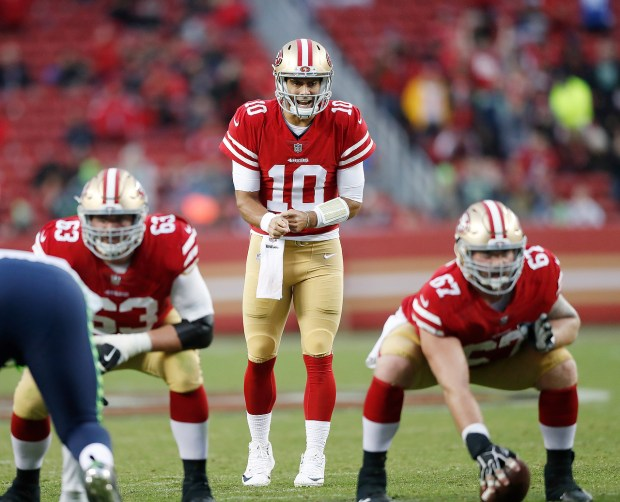 San Francisco 49ers' Brandon Fusco (63), San Francisco 49ers' Jimmy Garoppolo (10), San Francisco 49ers' Daniel Kilgore (67) against Seattle Seahawks in the fourth quarter of their NFL game at Levi's Stadium in Santa Clara, Calif. on Sunday, Nov. 26, 2017. (Josie Lepe/Bay Area News Group)