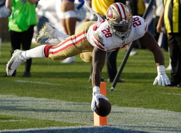 San Francisco 49ers running back Carlos Hyde scores against the Los Angeles Rams during the second half of an NFL football game Sunday, Dec. 31, 2017, in Los Angeles. (AP Photo/Rick Scuteri)