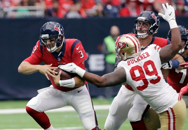 Houston Texans quarterback Tom Savage (3) is pressured by San Francisco 49ers defensive tackle DeForest Buckner (99) during the first half of an NFL football game, Sunday, Dec. 10, 2017, in Houston. (AP Photo/David J. Phillip)