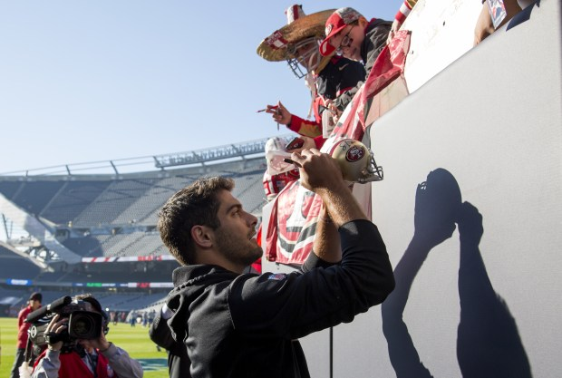 CHICAGO, IL - DECEMBER 03: Quarterback Jimmy Garoppolo #10 of the San Francisco 49ers signs autographs prior to the game against the Chicago Bears at Soldier Field on December 3, 2017 in Chicago, Illinois. (Photo by Kena Krutsinger/Getty Images)