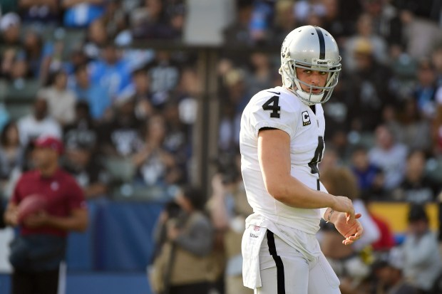 Derek Carr #4 of the Oakland Raiders reacts after an offensive penalty during the second quarter of the game against the Los Angeles Chargers at StubHub Center on December 31, 2017 in Carson, California. (Photo by Harry How/Getty Images)