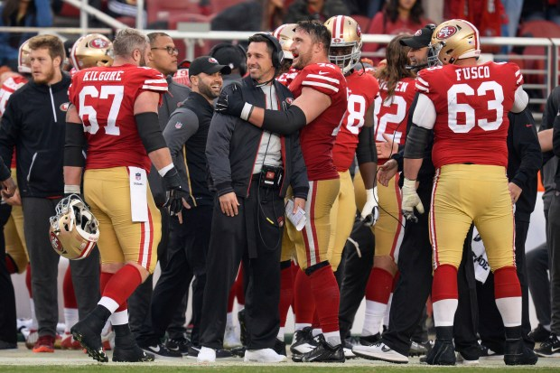 San Francisco 49ers' Joe Staley (74) congratulates San Francisco 49ers head coach Kyle Shanahan during the final minute of the fourth quarter of their NFL game against the Jacksonville Jaguars at Levi's Stadium in Santa Clara, Calif., on Sunday, Dec. 24, 2017. San Francisco defeated Jacksonville 44-33. (Jose Carlos Fajardo/Bay Area News Group)