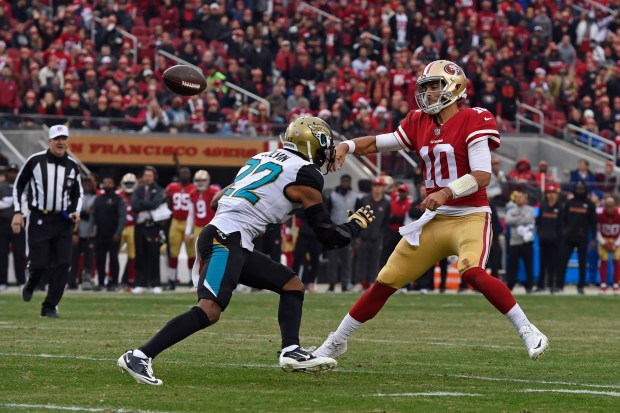 San Francisco 49ers quarterback Jimmy Garoppolo throws a touchdown pass despite the oncoming rush of Jaguars cornerback Aaron Colvin, a pending free agent with the Jaguars. (Jose Carlos Fajardo/Bay Area News Group)