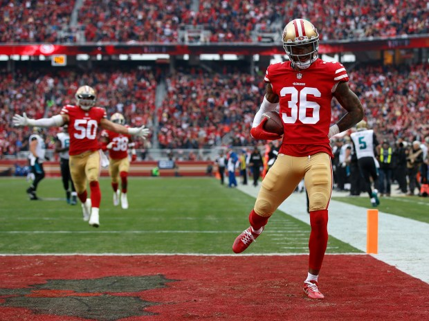 San Francisco 49ers' Dontae Johnson (36) celebrates his interception and touchdown against the Jacksonville Jaguars in the second quarter of their NFL game at Levi's Stadium in Santa Clara, Calif., on Sunday, Dec. 24, 2017. (Nhat V. Meyer/Bay Area News Group)