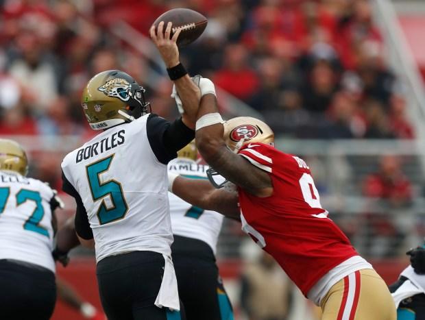 San Francisco 49ers' DeForest Buckner (99) forces an incomplete pass against Jacksonville Jaguars starting quarterback Blake Bortles (5) in the second quarter of their NFL game at Levi's Stadium in Santa Clara, Calif., on Sunday, Dec. 24, 2017. (Nhat V. Meyer/Bay Area News Group)