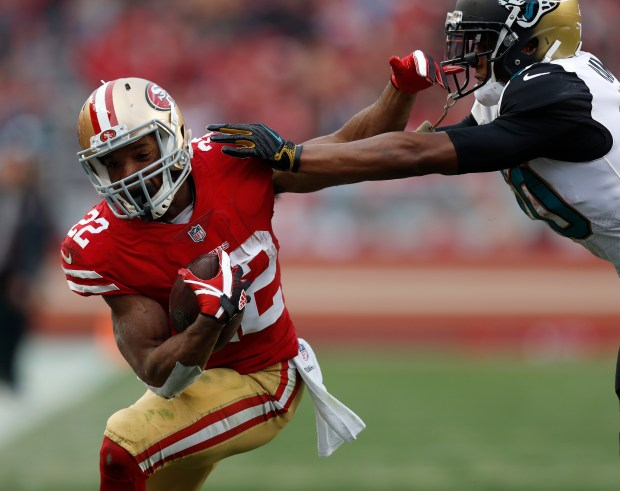 3f08be8b8 San Francisco 49ers  Matt Breida (22) runs against Jacksonville Jaguars   Jalen Ramsey