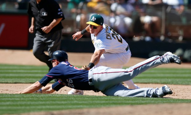 Oakland Athletics' Matt Chapman (26) tags out Minnesota Twins' Max Kepler (26) at third base on a fielders choice in the ninth inning at the Coliseum in Oakland, Calif. on Sunday, July 30, 2017. (Nhat V. Meyer/Bay Area News Group)