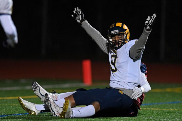 Milpitas' Tuni Faletau Fifita (9) gestures after scoring a touchdown after being tackled by Campolindo's Grant Larsen (42) in the second quarter of their CIF State NorCal Regional Division 4-A Championship football game at Campolindo High School in Moraga, Calif. on Saturday, Dec. 9, 2017. Milpitas defeated Campolindo 52-38. (Jose Carlos Fajardo/Bay Area News Group)