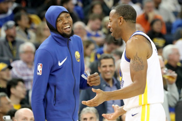 Golden State Warriors' Kevin Durant (35) and Andre Iguodala (9) share a light moment in the second half of an NBA game against the Dallas Mavericks at Oracle Arena in Oakland, Calif., on Thursday, Dec. 14, 2017. (Ray Chavez/Bay Area News Group)