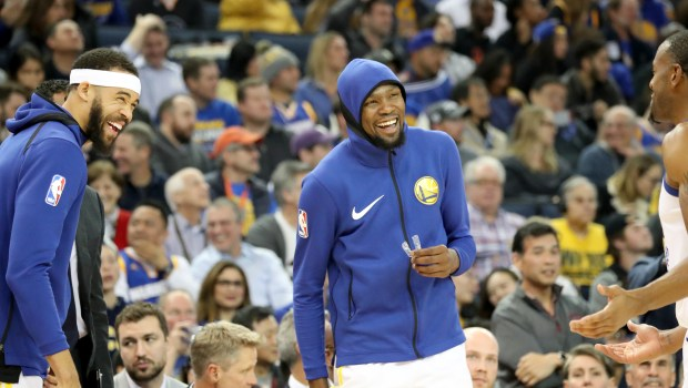 Golden State Warriors' JaVale McGee (1), Kevin Durant (35) and Andre Iguodala (9) share a light moment in the second half of an NBA game against the Dallas Mavericks at Oracle Arena in Oakland, Calif., on Thursday, Dec. 14, 2017. (Ray Chavez/Bay Area News Group)