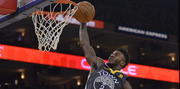Golden State Warriors' Jordan Bell (2) goes up for a dunk against the Denver Nuggets during the second quarter of their NBA game at the Oracle Arena in Oakland, Calif. on Saturday, Dec. 23, 2017. (Jose Carlos Fajardo/Bay Area News Group)