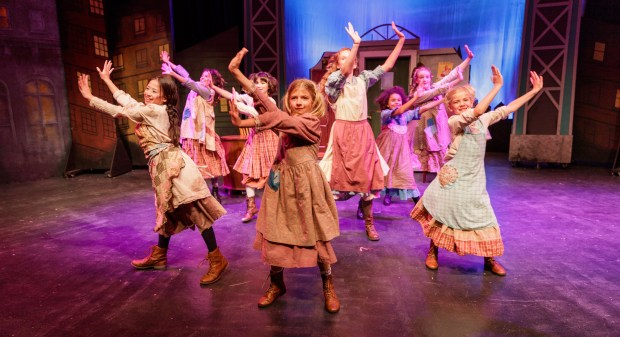 "The orphans of ""Annie"" have things to sing and dance about in the production at Hillbarn Theatre in Foster City. The popular musical is running Nov. 30 through Dec. 17, 2017. (Mark and Tracy Photography / Hillbarn Theatre)"
