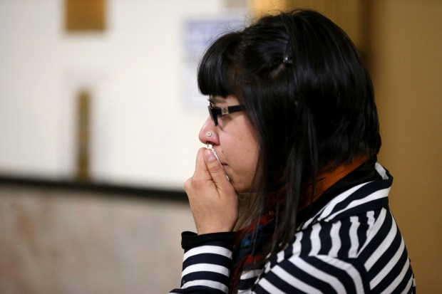 "Friend of Max Harris, Elissa Roy looks on as defense attorneys speak with the news media following a preliminary hearing for Harris and ""Ghost Ship"" co-defendant Derick Almena at the René C. Davidson Courthouse in Oakland, Calif., on Thursday, Dec. 14, 2017. Judge Jeffrey Horner ordered defendants Harris and Almena to stand trial, each on 36 counts of involuntary manslaughter stemming from the deadly Dec. 2, 2016 fire at the warehouse. (Anda Chu/Bay Area News Group)"