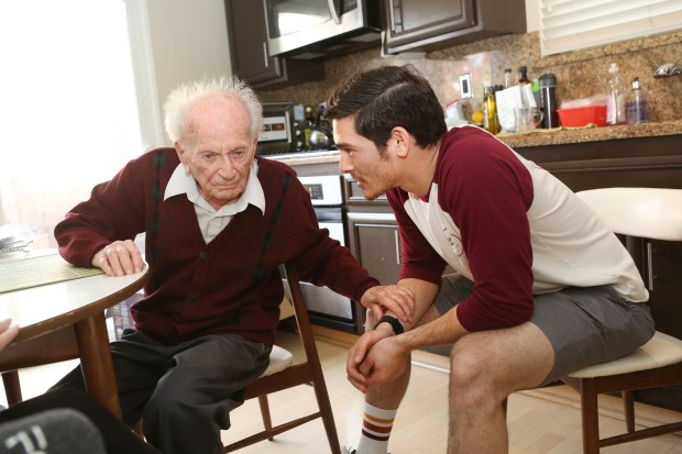 Los Gatos resident Emil Hopner, who turned 100 today, talks with his 23-year-old son Ben about World War II. Ben is writing a book about his father's amazing life and his journey through war-torn Europe to freedom. (George Sakkestad\Staff Photographer)