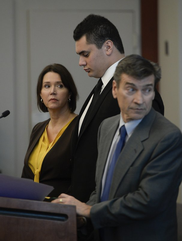 In this Tuesday, Dec. 5, 2017 photo, Osa Masina, center, appears with his defense attorneys Greg and Rebecca Skordas in court for his sentencing hearing at the Matheson Courthouse in Salt Lake City. Masina, a suspended University of Southern California football player who pleaded guilty to misdemeanor sexual assault, has been sentenced to one year in a Utah jail. The Deseret News reports that 20-year-old Masina, a Utah native, was sentenced Tuesday, Dec. 5, 2017, for three counts of sexual battery. (Francisco Kjolseth/The Salt Lake Tribune, via AP, Pool)