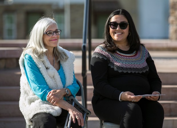 From left, Charlotte Mankin, daughter of Elaine Richardson, and Rachel Moreno, granddaughter of Elaine Richardson, smile during the unveiling of Elaine Richardson Park in San Jose, California on Saturday, December 9, 2017. (LiPo Ching/Bay Area News Group)