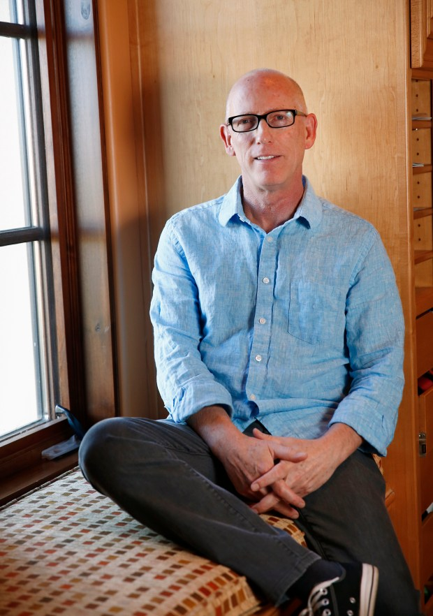 "Scott Adams, creator of the the comic strip, ""Dilbert"", is photographed at his home in Pleasanton, California, on Monday, Dec. 4, 2017. Adams recently authored ""Win Bigly, Persuasion in a World Where Facts Don't Matter"" that examines the strategies that Donald Trump used to win the presidency. (Gary Reyes/ Bay Area News Group)"