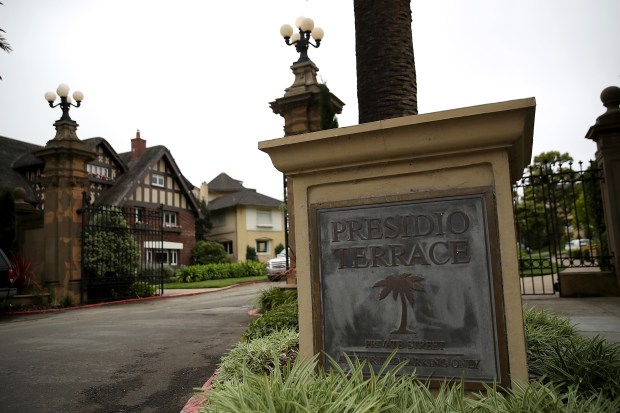 SAN FRANCISCO, CA - AUGUST 09: A sign is posted at the entrance to Presidio Terrace on August 9, 2017 in San Francisco, California. California couple Tina Lam and Michael Cheng purchased the streets and sidewalks of Presidio Terrace, a private cul-de-sac that features several multi million dollar mansions, for $90,000 at public auction. The couple was able to purchase the street and common areas when the home owner's association defaulted on the property tax for the street. (Photo by Justin Sullivan/Getty Images)