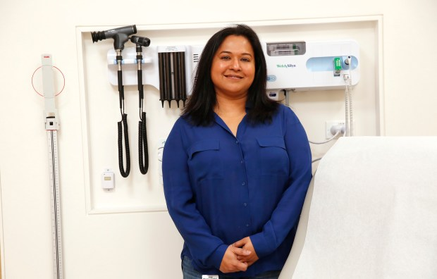 Dr. Saba Haq is photographed in an exam room at the Crossover Health medical clinic in Sunnyvale, California, on Thursday, Dec. 7, 2017. Some Silicon Valley tech companies have contracts with health care companies like Crossover Health to provide their employees with primary health services completely outside of the traditional, fee-for-service model used by health insurance companies. (Gary Reyes/ Bay Area News Group)