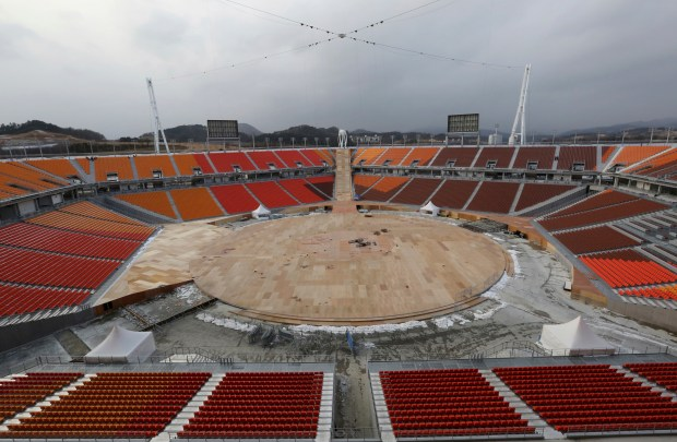 The Pyeongchang Olympic Stadium is under construction in Pyeongchang, South Korea, Saturday, Nov. 25, 2017. South Korea's Pyeongchang is the host city of the 2018 Olympic and Paralympic Winter Games which will be held from February 2018. (AP Photo/Ahn Young-joon)
