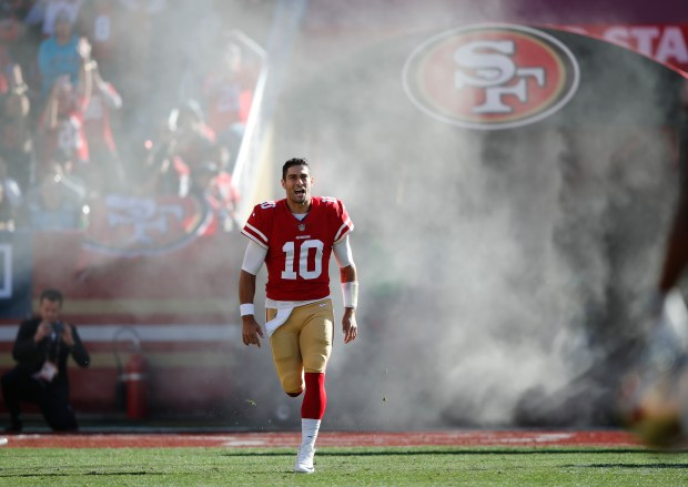 San Francisco 49ers quarterback Jimmy Garoppolo (10) is introduced before an NFL football game against the Tennessee Titans, Sunday, Dec. 17, 2017, in Santa Clara, Calif. (AP Photo/John Hefti)