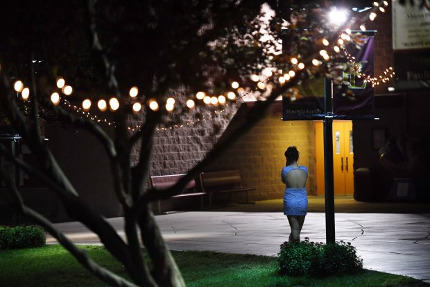 Shae Turner stands by herself and talks on the phone with her father whileattending a homecoming dance at Faith Lutheran Middle School and High School on Oct. 7 in Las Vegas. MUST CREDIT: Washington Post photo by Matt McClain