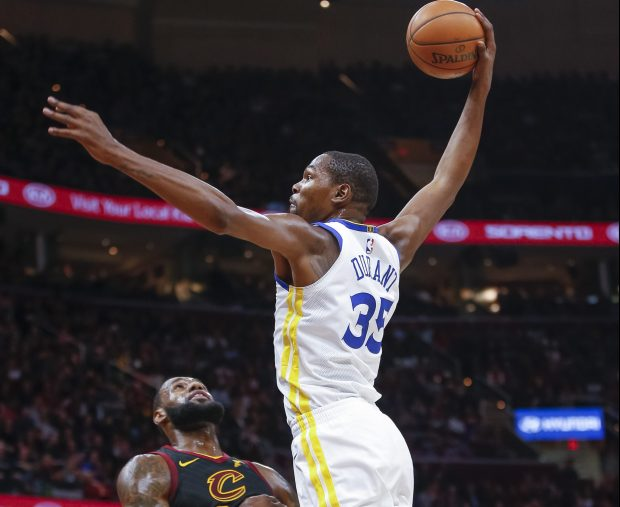 CLEVELAND, OH - JANUARY 15: Kevin Durant #35 of the Golden State Warriors goes up for the dunk over LeBron James #23 of the Cleveland Cavaliers at Quicken Loans Arena on January 15, 2018 in Cleveland, Ohio. NOTE TO USER: User expressly acknowledges and agrees that, by downloading and or using this photograph, User is consenting to the terms and conditions of the Getty Images License Agreement. (Photo by Michael Hickey/Getty Images)