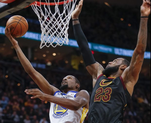 CLEVELAND, OH - JANUARY 15: Kevin Durant #35 of the Golden State Warriors shoots the ball against LeBron James #23 of the Cleveland Cavaliers at Quicken Loans Arena on January 15, 2018 in Cleveland, Ohio. NOTE TO USER: User expressly acknowledges and agrees that, by downloading and or using this photograph, User is consenting to the terms and conditions of the Getty Images License Agreement. (Photo by Michael Hickey/Getty Images)
